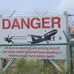 St-Maarten-Martin-Maho-Beach-Danger-Sign-TravelXena