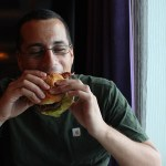 Eating-Burger-Taste-Norwegian-Breakaway-TravelXena