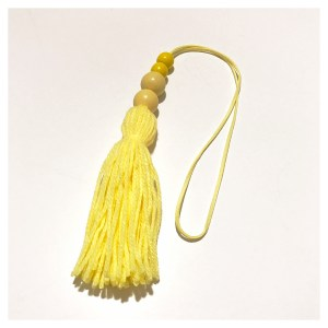 yellow tassel wall hangings
