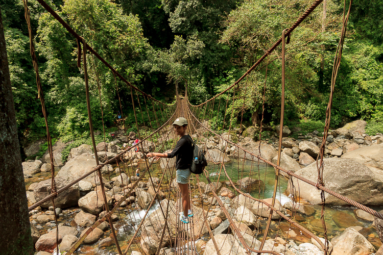 Medarisha on one of the many rope bridges on the route