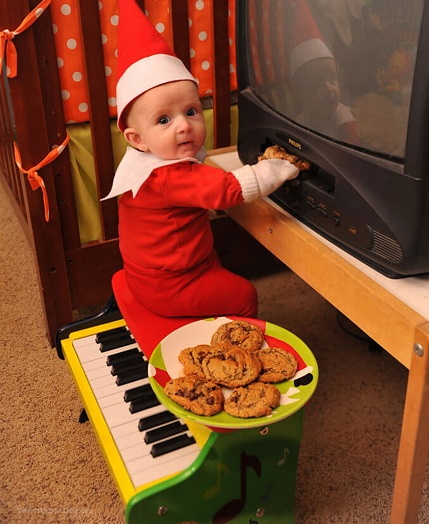 Baby hiding cookies elf on the shelf