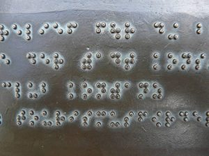 An image of braille lettering.