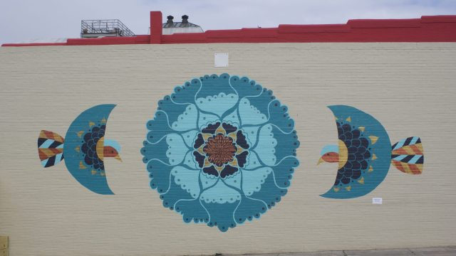 Laura Lashley's new mural decorates the side of Small Batch Beer Co. in Winston-Salem. (Photo by Eric Ginsburg)