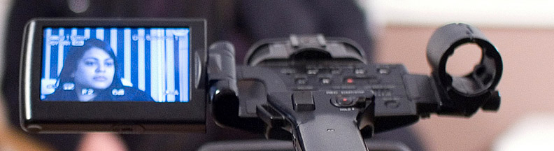 A close-up photo of a video camera setup for an interview — Two reasons to adopt video marketing