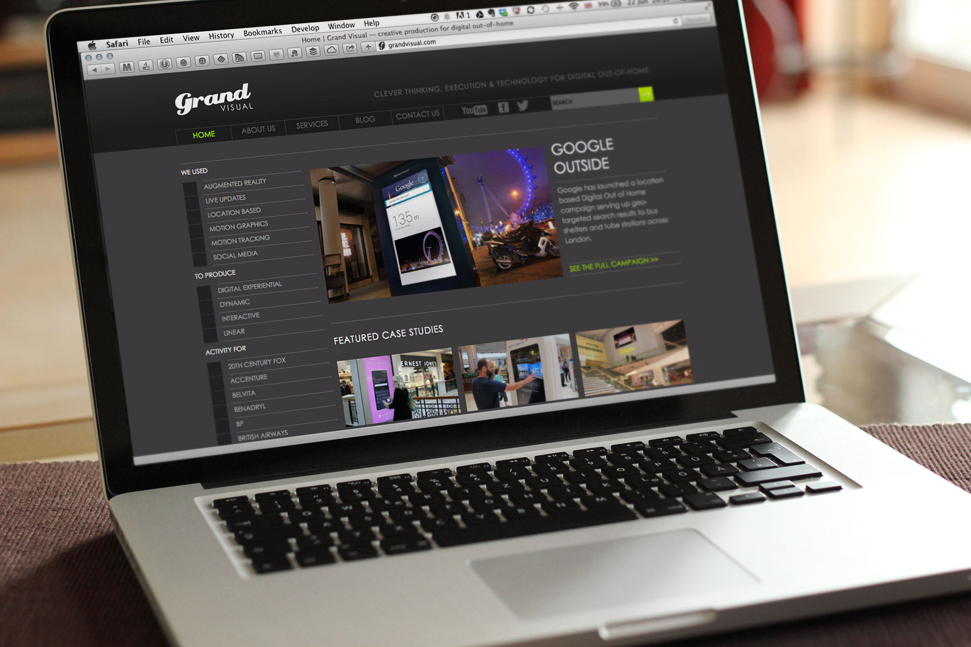 The Grand Visual website homepage displayed on a laptop — Tribus Creative, web design for small business