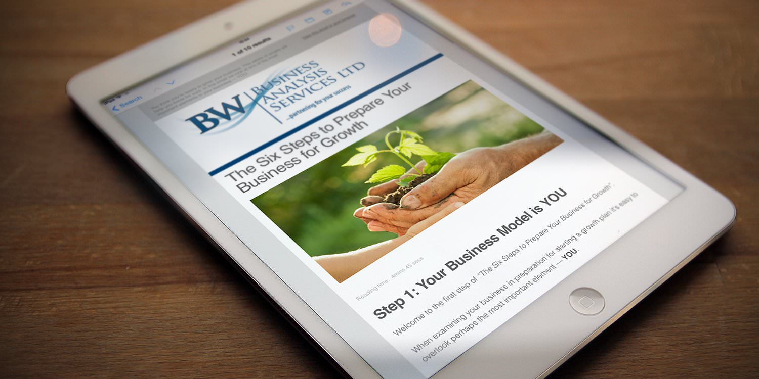 An iPad displaying a BW Business Analysis services content marketing campaign email – Tribus Creative – content marketing for small business