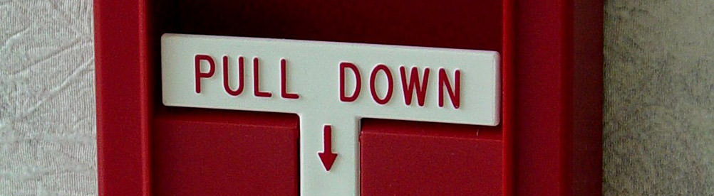 A photo of a fire alarm box with lever – calls to action