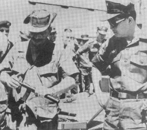 werbell showing silencer to asian military
