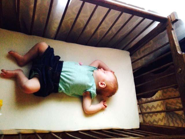 Sleeping in Grandpa's Bassinet