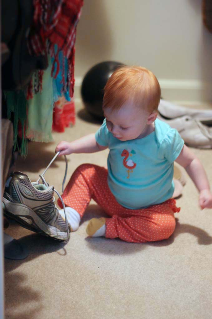 Eight-Month Old Baby Playing in Mommy's Closet
