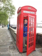 Cell phones have replaced the classic red phone booths on the streets of London, but they still beg for photos.