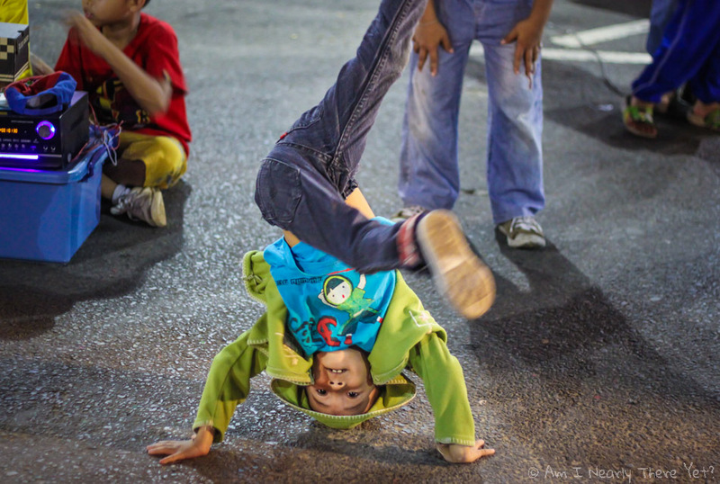 When we stayed in Krabi,Thailand, there was a big local festival – The streets were packed with locals all having a great time – eating, drinking and breakdancing!! These kids were pretty hard-core – no spin mat or anything, just spinning on the bare concrete. They make them tough in Thailand!