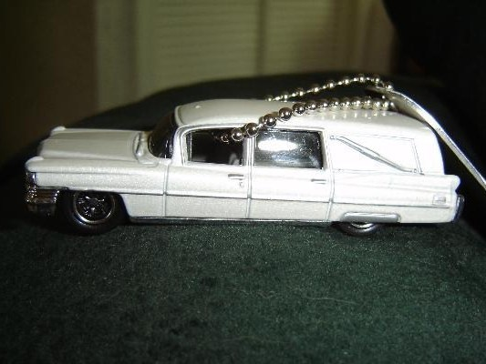 A Geocaching Travel Bug Story: The Well-Traveled Cadillac Hearse