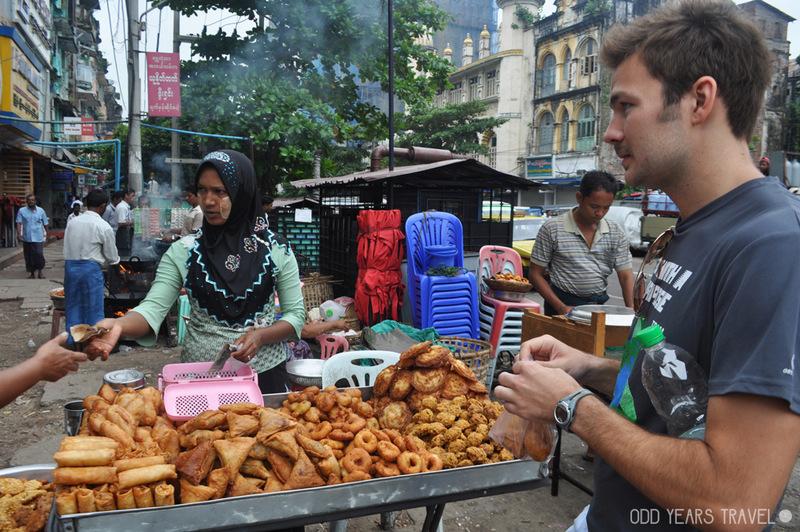 Buying samosas on the street in Yangon, Myanmar.