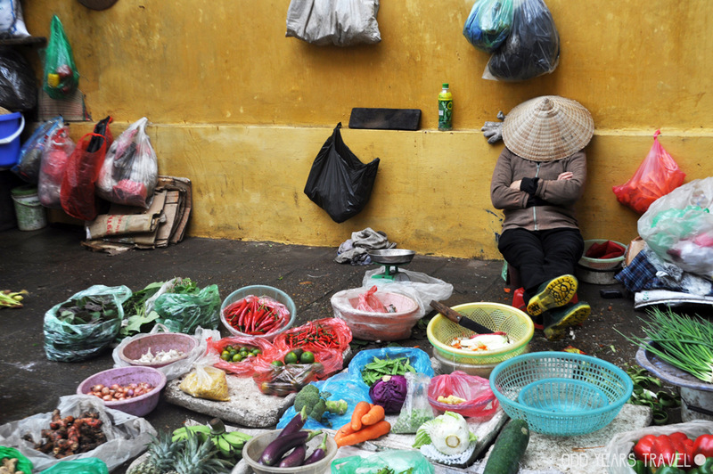Sleepy vegetable vendor in Vietnam.
