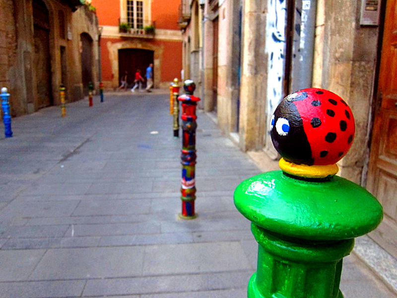 Colorful Bollards line the Carrer de Comte (Calle de los Pilones) in Old Town, Tarragona, Spain