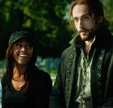 Abbie (Nicole Beharie) and Ichabod (Tom Mison) smile at a baseball game