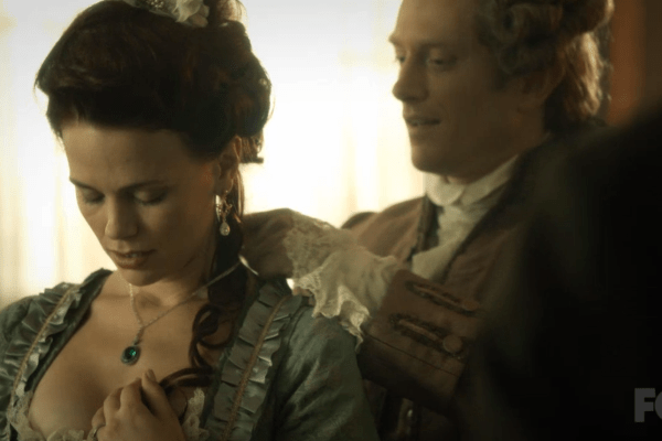 Abraham puts a necklace on Katrina on Sleepy Hollow