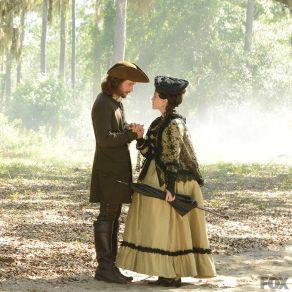 Ichabod (Tom Mison)  takes Mary Wells' (Heather Lind) hand.
