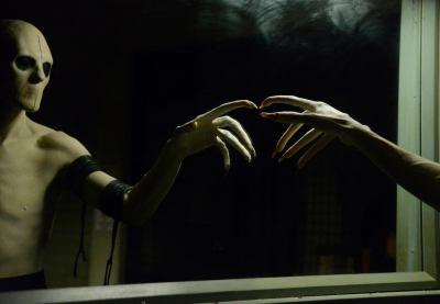The Sandman points at a window on Sleepy Hollow