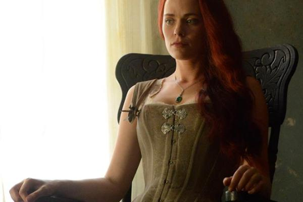 Katrina sits in a rocking chair on Sleepy Hollow