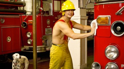 Shirless Mark Orlando poses as he cleans a fire truck on Burning Love