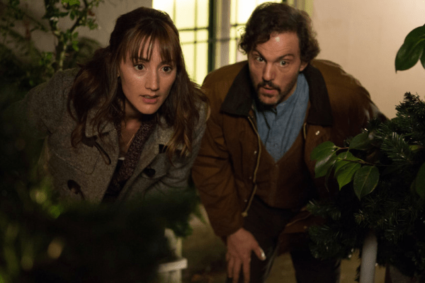 Rosalee and Monroe crouch behind bushes on Grimm.