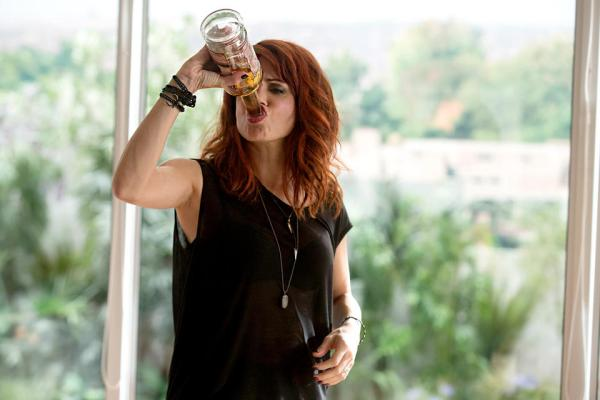 Jo drinks straight from bottle at Thanksgiving on Girlfriends' Guide to Divorce.