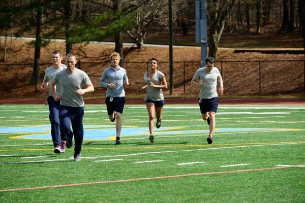 Alex Parrish and other recruits jog on Quantico