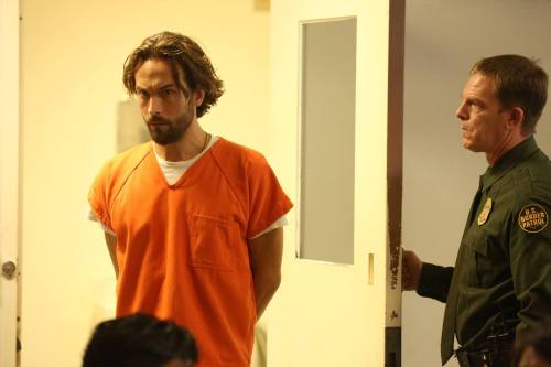 "Sleepy Hollow's Ichabod Crane (Tom Mison) in an orange jumpsuit on the episode ""I, Witness."""