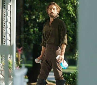 Ichabod Crane (Tom Mison) does windows on Sleepy Hollow