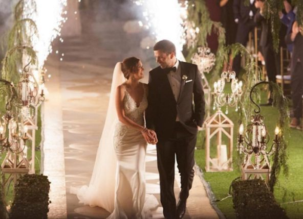 Ashley and Tanner walk down the aisle after their wedding