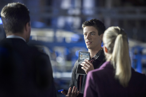 "Arrow -- ""The Scientist"" -- Image AR208b_0204b -- Pictured (L-R): Stephen Amell as Oliver Queen, Grant Gustin as Barry Allen, and Emily Bett Rickards as Felicity Smoak -- Photo: Cate Cameron/The CW -- © 2013 The CW Network. All Rights Reserved"