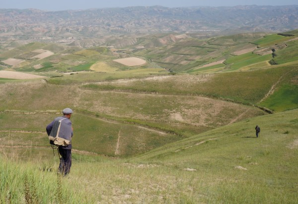 Herdsman over the valley of Xin Zhan, Yongdeng, Gansu