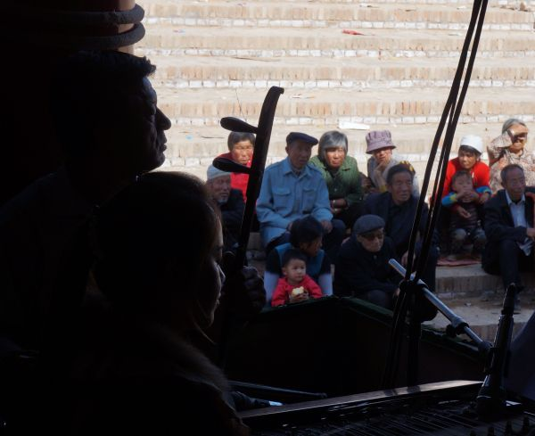 Musicians and audience at the temple fair