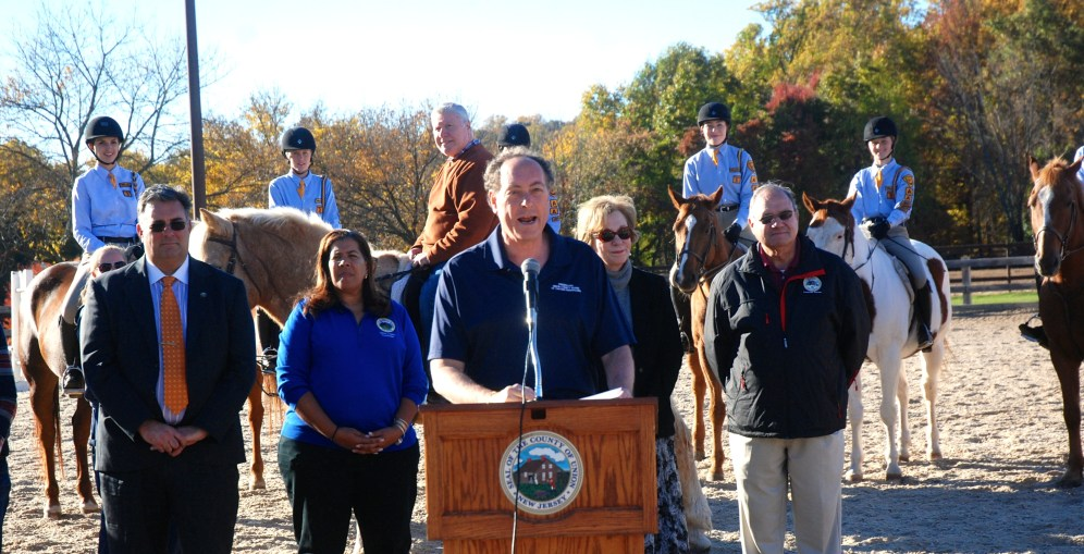 Union County Freeholder Vice Chairman Bruce Bergen speaks before audience with stable riders and County leaders.