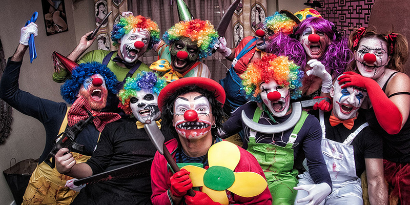Photo: A group of clowns pose with fake weapons. Photo courtesy of: Gaudencio Garcinuño, Flickr https://www.flickr.com/photos/31112252@N00/15696955002