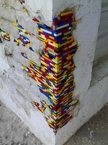 deteriorating brickwork patched with Lego bricks