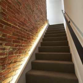 stairwell brick wall