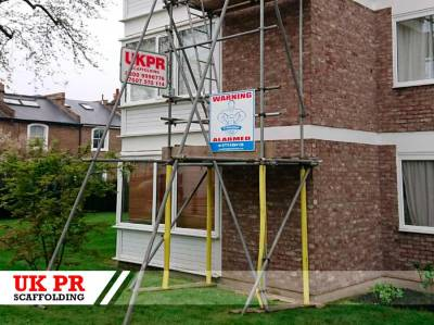 Three scaffolding towers on residential estate