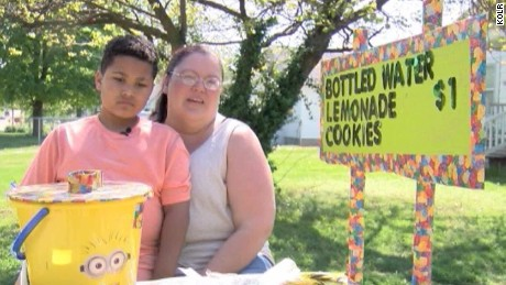 Boy's lemonade stand raises thousands for his own adoption