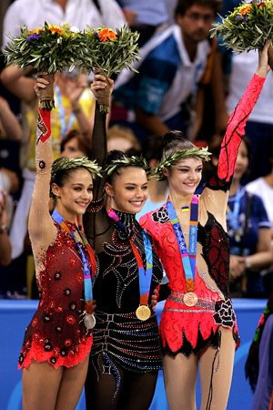 Medalists (L-R) Irina Tchachina of Russia (silver), Alina Kabaeva of Russia (gold) and Anna Bessonova of Ukraine (bronze), wave to fans at 2004 Athens Olympics.