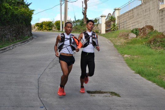 Gerald Sabal and Marcelo Bautista during a training run in Baguio, Philippines