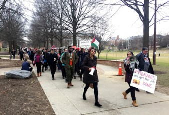 Miranda Mlilo, president of Students for Justice in Palestine, leads protesters on their march from McKeldin Library toward the Main Administration Building. Jack Wisniewski/Mitzpeh.
