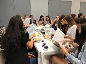 Students examine their haggadahs during the seder. Rebecca Cohen/Mitzpeh.