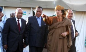 epa02680815 Jacob Zuma of South Africa, (L) Denis Sassou Nguesso of Congo (2-L), Libyan leader Muammar Gaddafi, (C) Mohamed Ould Abdel Aziz of Mauritania (R) outside a tent erected at Gaddafi's Bab al-Aziziya residence in Tripoli, Libya, on 10 April 2011. Reports state that South African President Jacob Zuma was greeted by pro-Gaddafi supporters in the capital carrying banners reading 'No to Foreign Intervention,' regional broadcaster Al Jazeera reported. Zuma is part of the five-strong AU panel, chaired by Mauritania President Mohamed Ould Abdel Aziz. The AU mediators were expected to meet with members of the embattled Libyan government before traveling to the rebel stronghold of Benghazi. EPA/MOHAMED MESSARA EPA/MOHAMED MESSARA