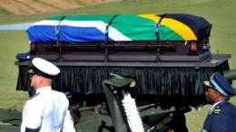 Madiba's casket carried by military and police members during his funeral service in Qunu