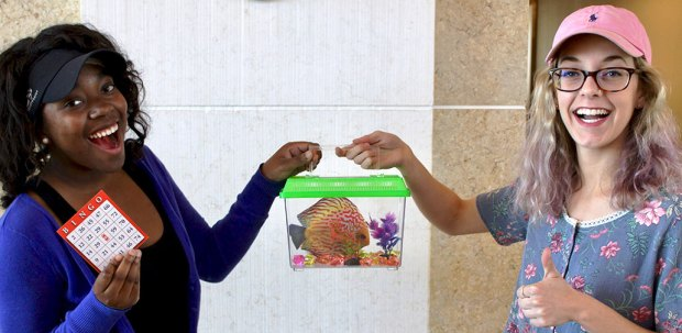 Kierra Johnson is gifted an exotic fish to enter a game of bingo. (Photo by Sean Atkinson)