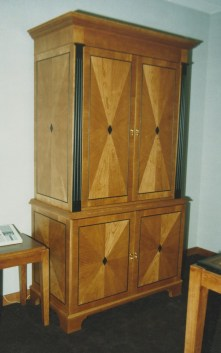 Starburst cherry veneered liquor cabinet with black accents