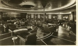 THE NEW LOOK: First class smoker makes use of inlaid linoleum patters on the floor and curvilinear recessed lighting overhead Photo from the L Driscoll collection